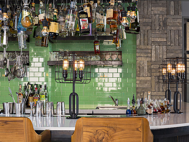 unique bar area with hanging drink bottles