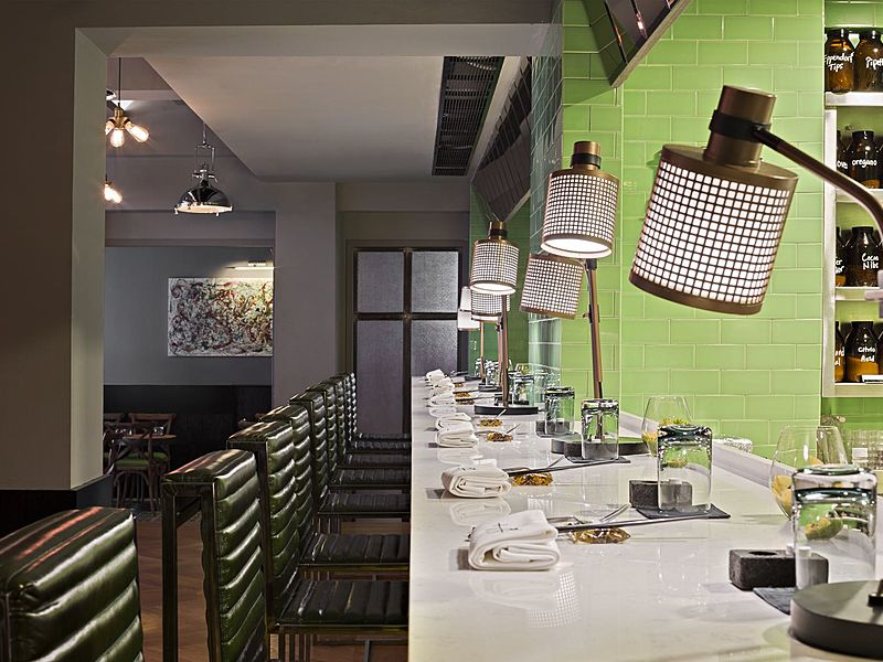 restaurant dinner area with high chairs and table lamp