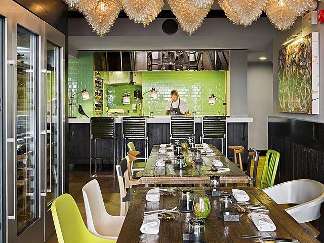 restaurant area with chandelier and wine racks