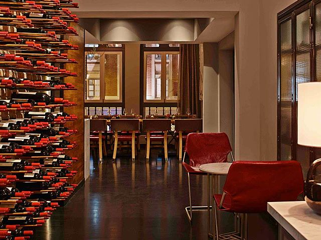 lot of wine on the wall near the private dining room