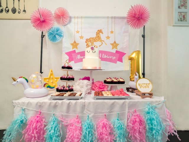 kids birthday party dessert table with unicorn theme