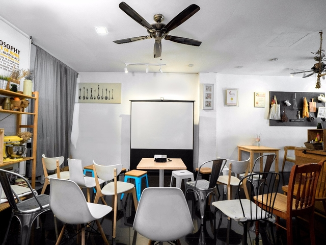 corporate workshop and training room setting with big screen