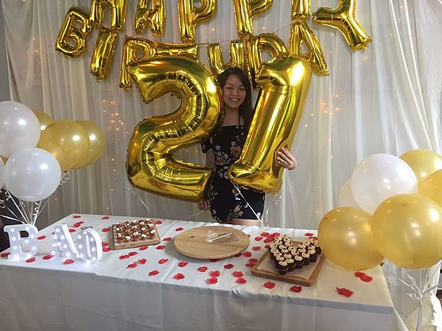 woman celebrate 21st birthday party holding