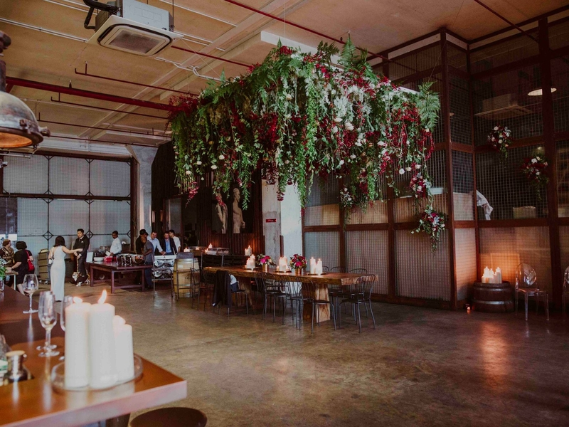 industrial warehouse venue with gleaming chandeliers
