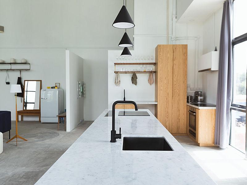 kitchen area with black sink