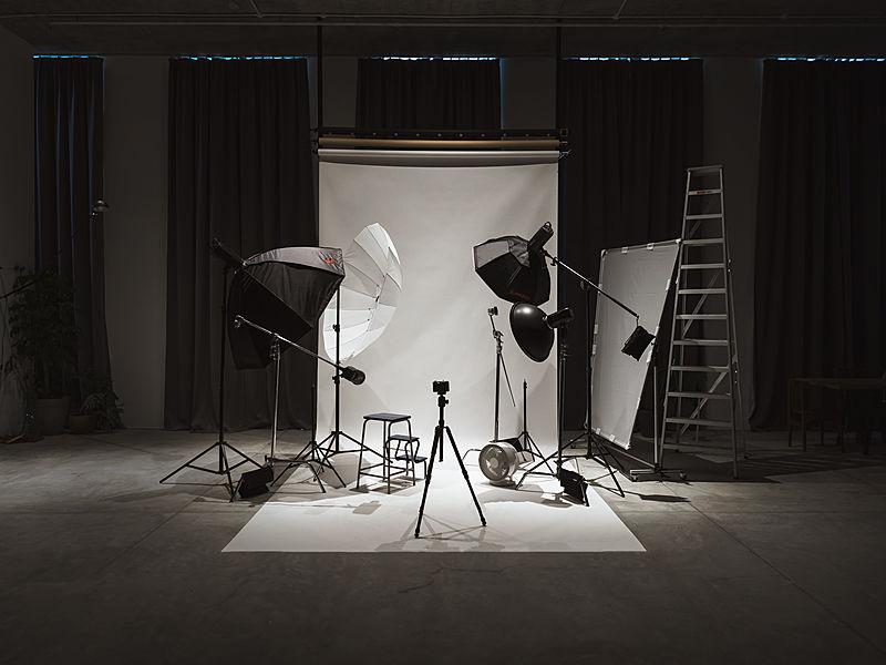 photoshoot setup with screen and camera lighting equipment