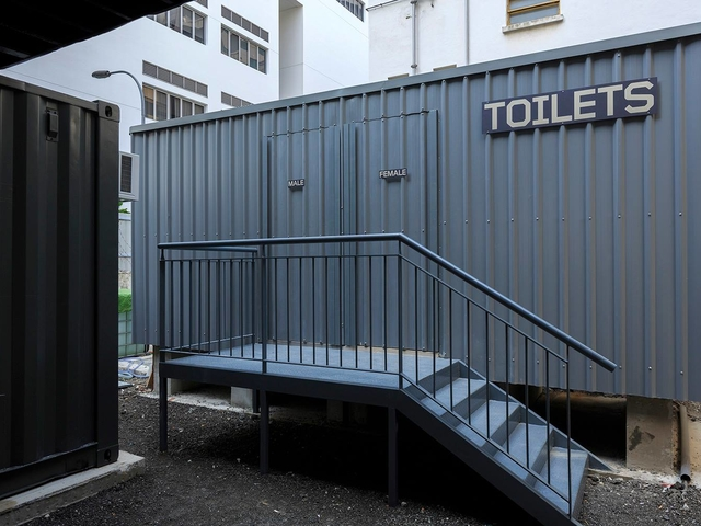 black container toilets by deck