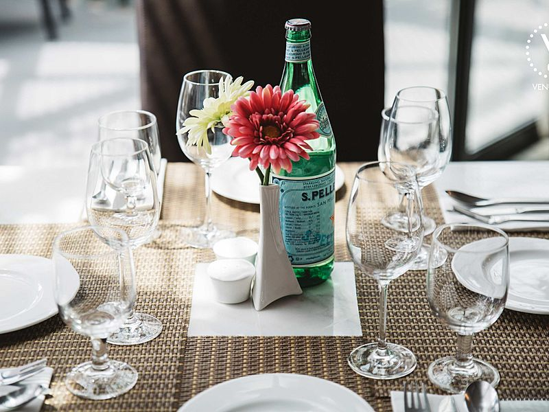 table area decoration with flower and glass for wine