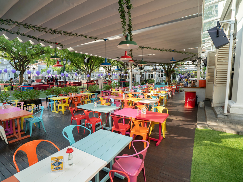 outdoor alfresco area with colourful chairs