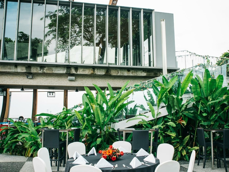 outdoor restaurant with garden and view of sentosa
