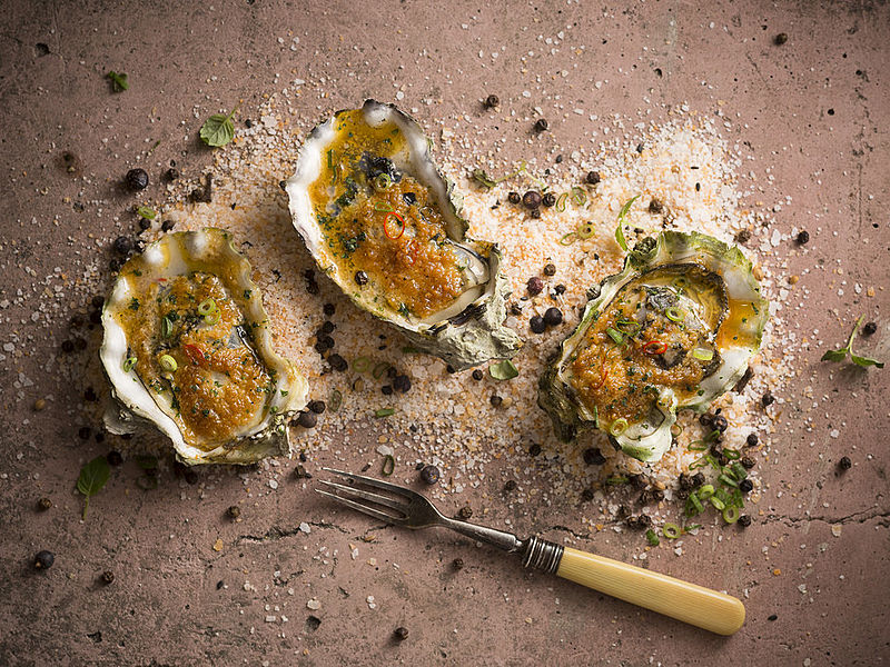 grilled fresh oyster with garlic and lime leaves