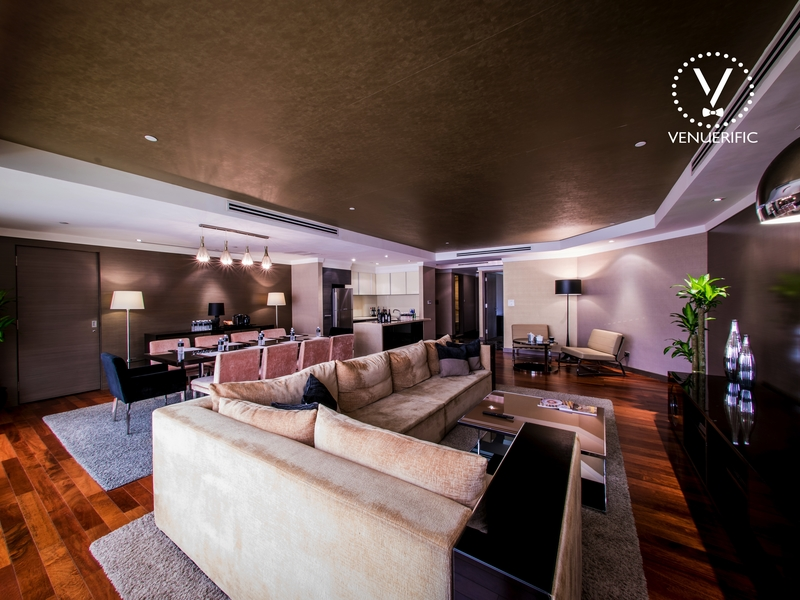 staycation space swathed in rich shades of deep brown, natural wood and cream interior