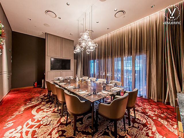 small private dining room with red and gold combination carpet and elegant design