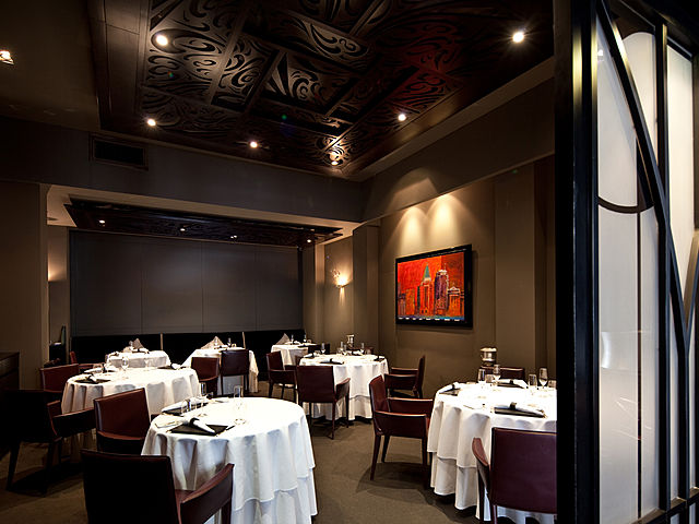 fine dining restaurant with dark intimate theme and painting