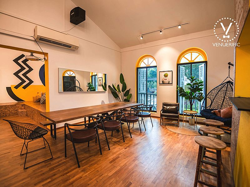 modern look venue with two window with long table and chair