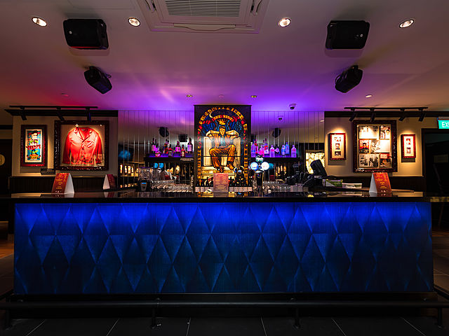 beautiful bar with blue light and classic design with purple light celling