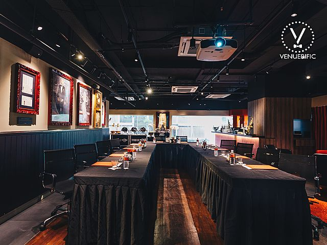 private event space with long black table set up