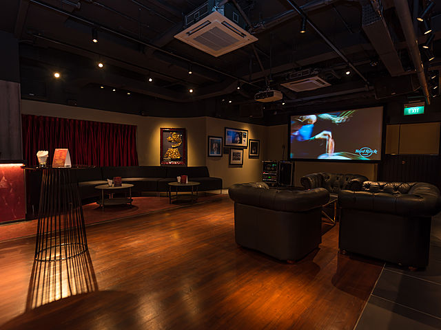 lounge for private event with classic design with couch and screen projector