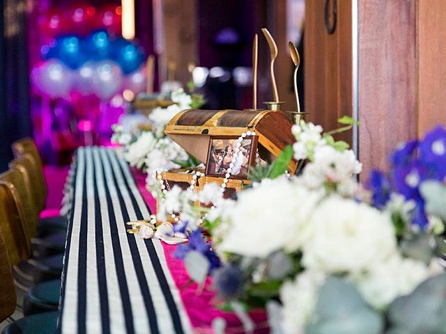table decoration with white flower and striped fabric and gold accessories