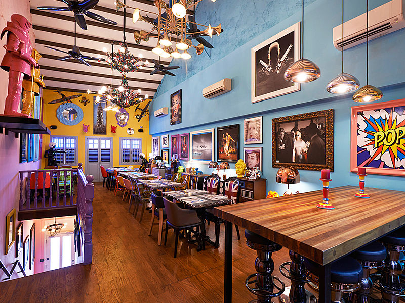 restaurant with heroes themes and lot of paintings on the wall