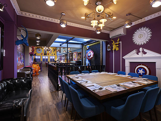 captain america theme room with table set up for kids birthday party