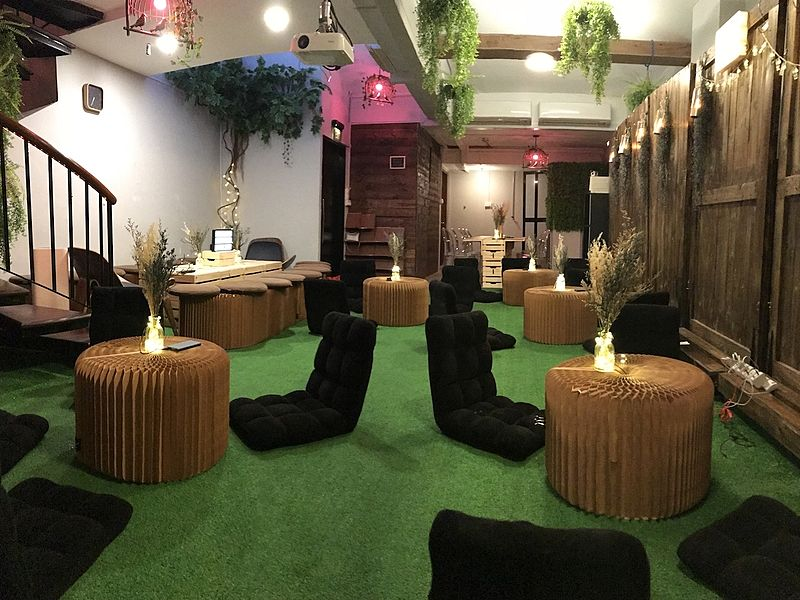 venue space for casual party with bean bag and round table