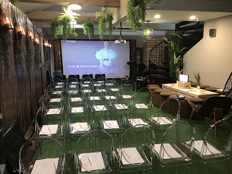 event space for 50 capacity with screen projector in the wood theme room