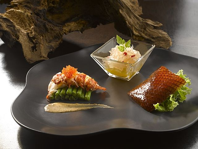 three types of chinese food appetizer served on the plate