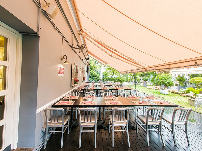 outdoor dining area with long table