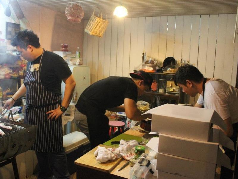 kitchen team preparing food for event