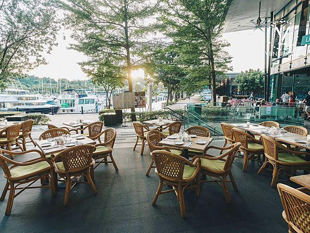 outdoor event space with wood table and chair