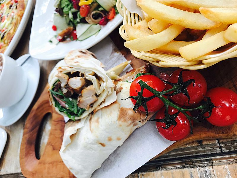 burrito with french fries and tomato