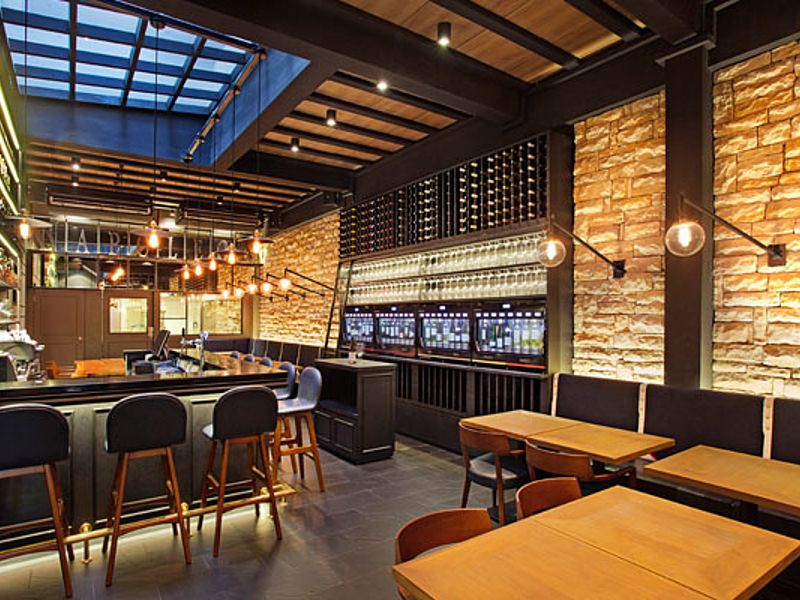 restaurant with wine bar and brick wall