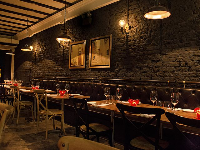 elegant dining restaurant with black brick wall