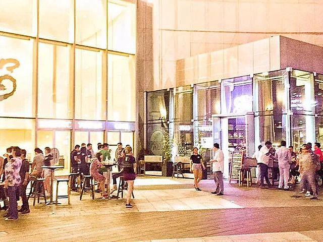 customers enjoying outdoor space at night