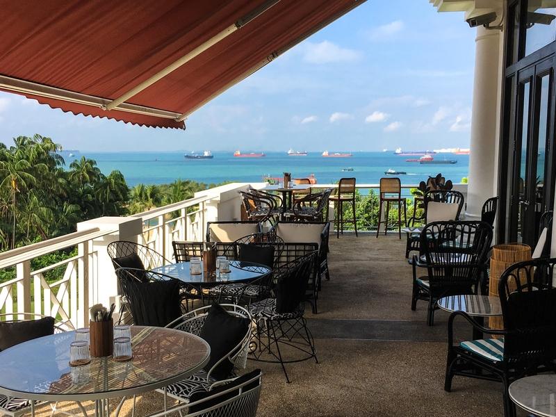 outdoor restaurant with blue ocean view