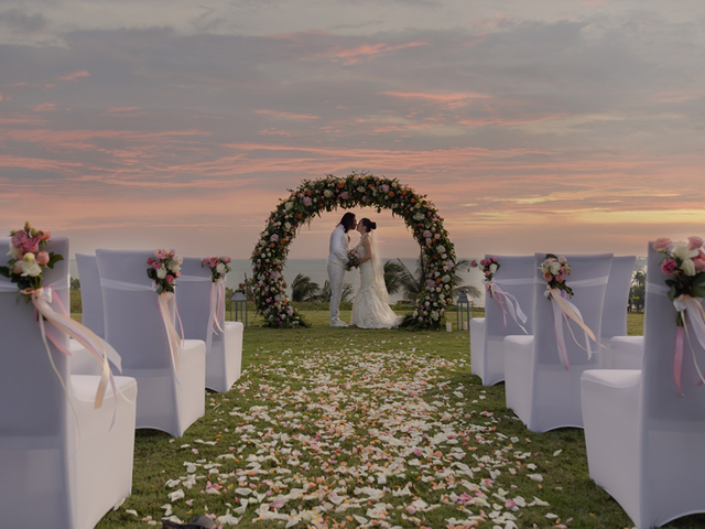 couple kissing in solemnisation with sunset view