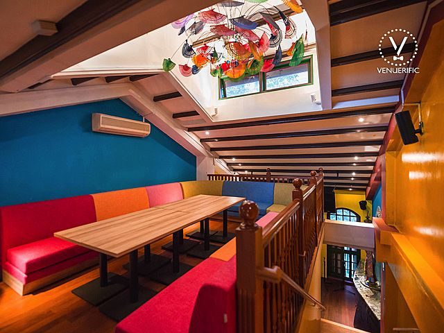 second floor bar with colourful couch