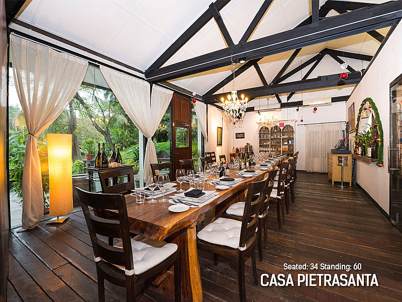 restaurant dining room with glass wall and long wooden table