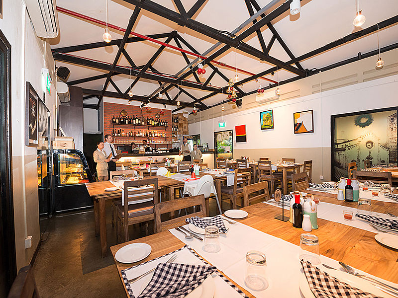 singapore restaurant with wooden interior and patterned napkins
