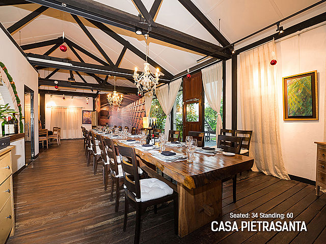 indoor rustic restaurant with pendant lamps and wooden interior