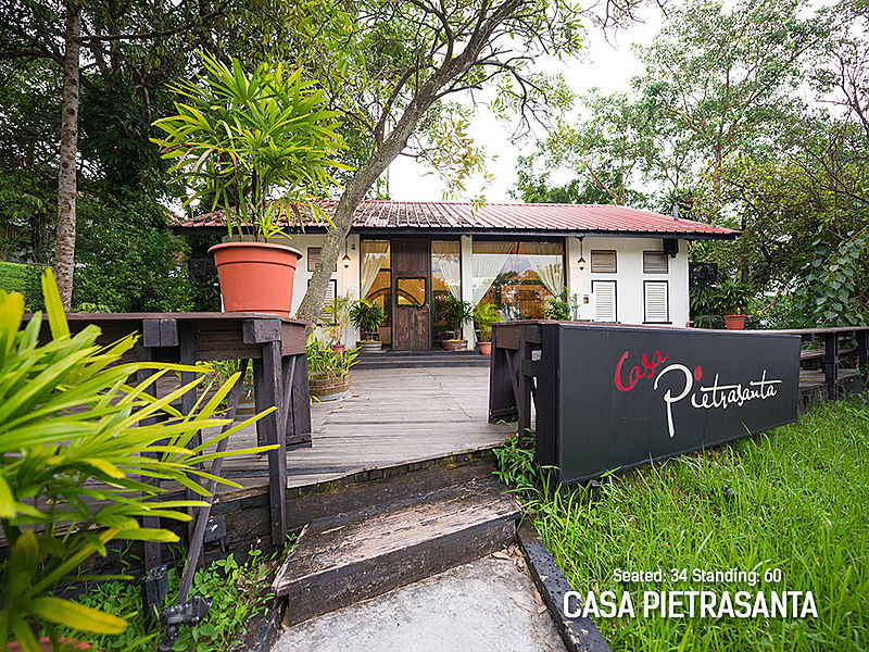 ristorante pietrasanta singapore frontage with large terrace and tree surrounds