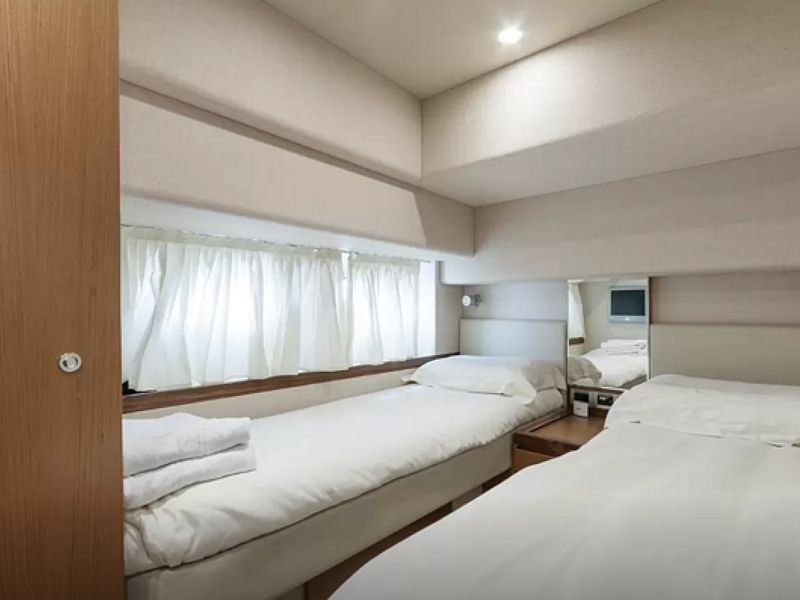 yacht twin bedroom with white colour and wooden doors