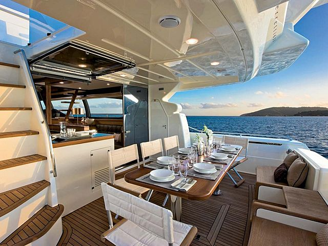yacht outdoor dining area with sea view and folding chairs