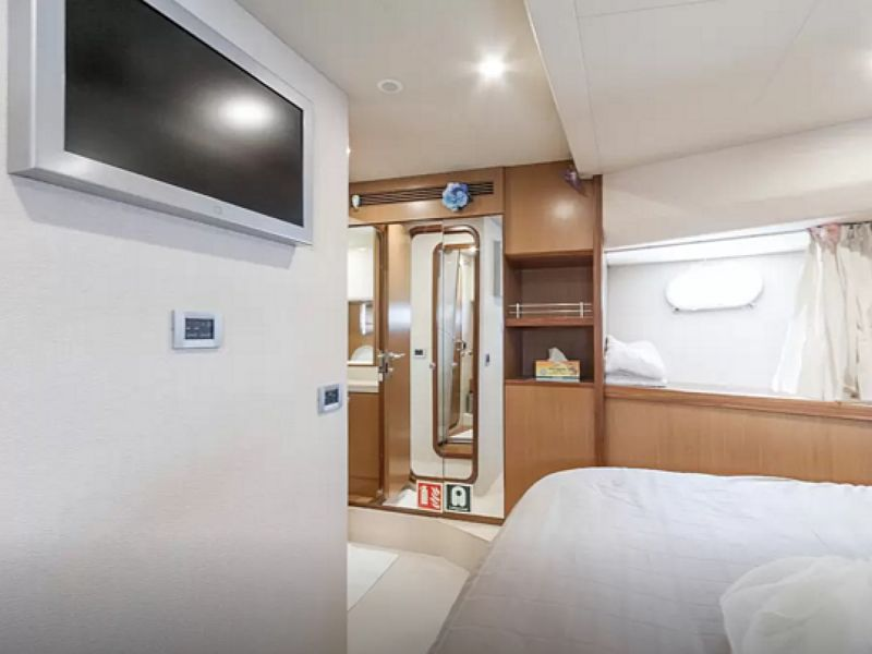 yacht white bedroom equipped with screen and bathroom