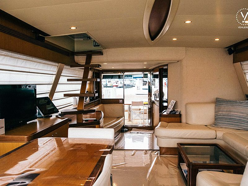 yacht cabin lounge area equipped with couch and television