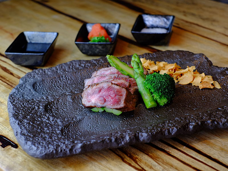 japanese meat dishes served in a rock plate