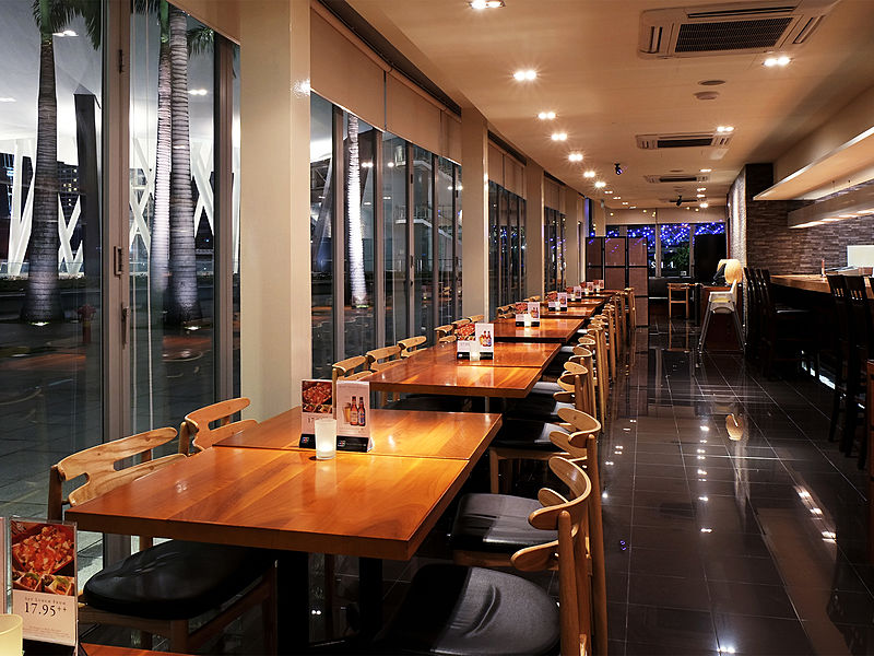 black floors japanese restaurant with wooden tables and fixed windows