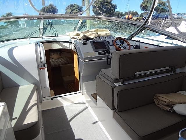 yacht bridge room with fixed window and some couch