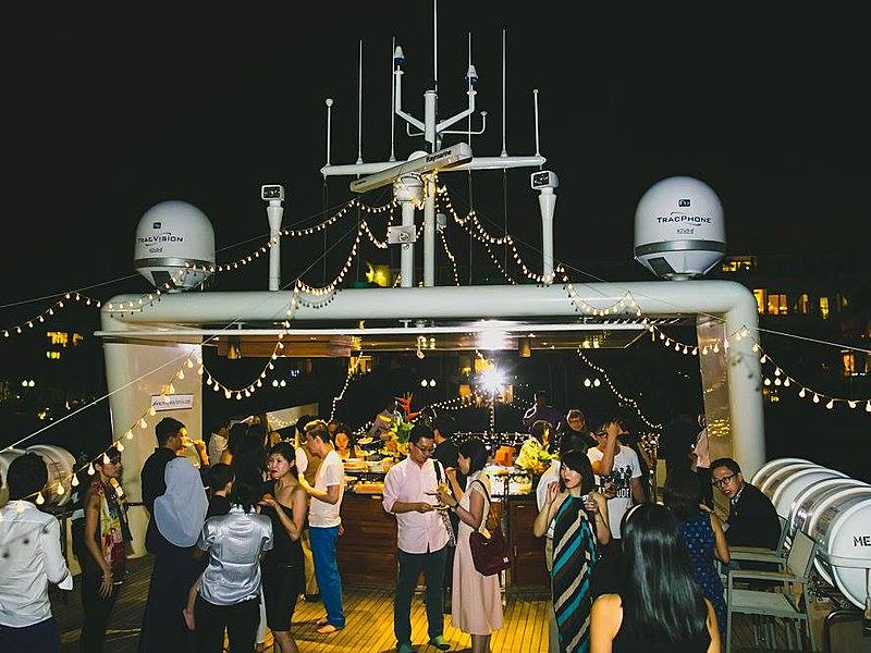 people joining night event party on the singapore yacht
